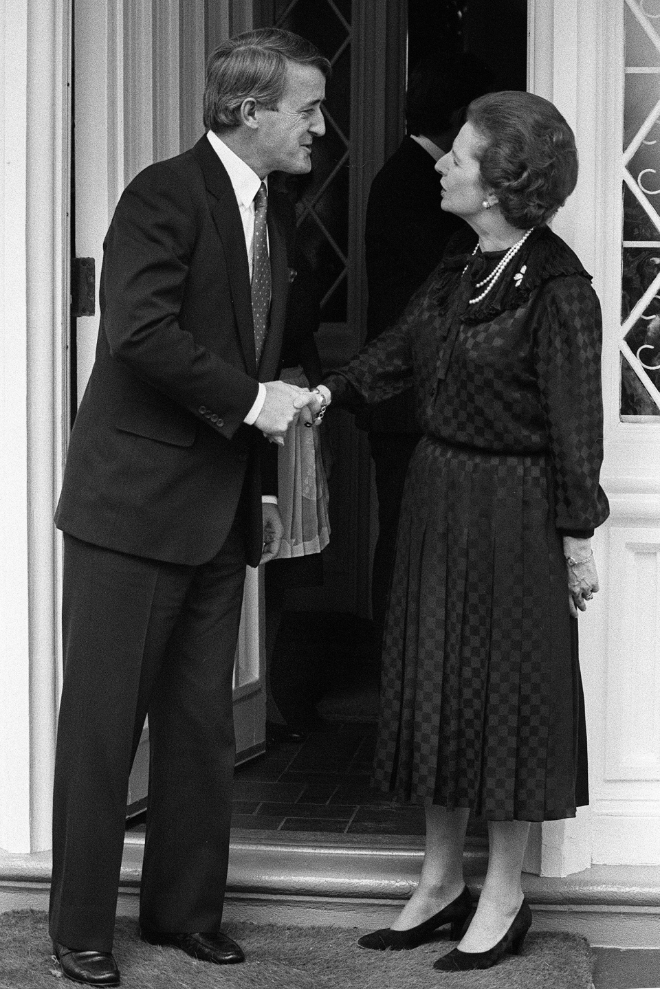 Opposition leader Brian Mulroney shakes hands with British Prime Minister Margaret Thatcher as he leaves the British High Commissioners residence in Ottawa on Sept. 26, 1983. (Ron Poling / The Canadian Press)