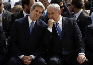 Israeli Prime Minister Benjamin Netanyahu, right, speaks with U.S. Secretary of State John Kerry during the annual ceremony marking Holocaust Remembrance Day at the Yad Vashem memorial in Jerusalem, Israel, Monday, April 8, 2013. (AP / Gali Tibbon)