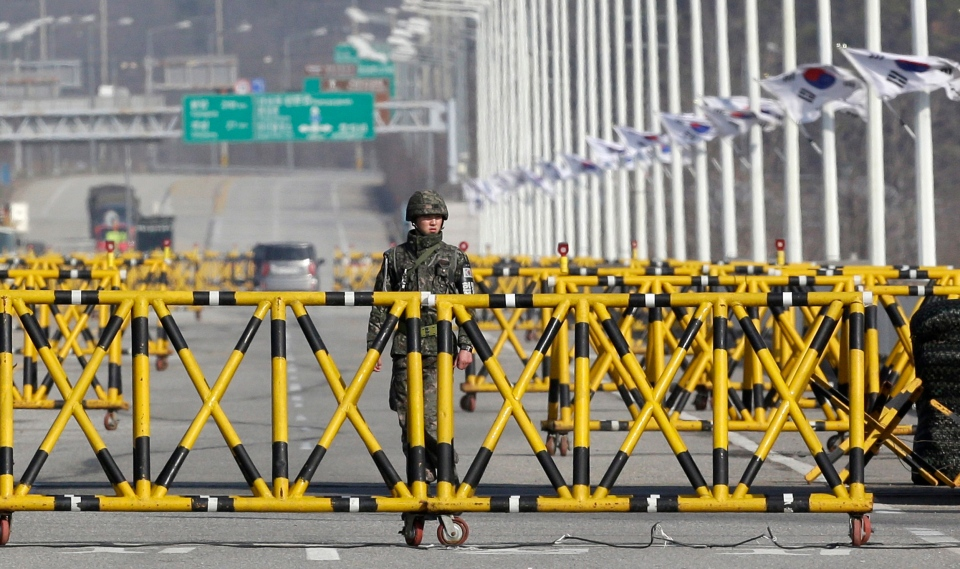 A South Korean soldier stands guard at barricaded Unification Bridge near the border village of Panmunjom, that has separated the two Koreas since the Korean War, in Paju, north of Seoul, South Korea, Tuesday, April 9, 2013. (AP / Lee Jin-man)