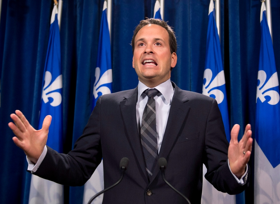 Alexandre Cloutier, Quebec minister for intergovernmental affairs reacts to a book by Frederic Bastien on irregularities on the repatriation of the Canadian Constitution, Tuesday, April 9, 2013 at the legislature in Quebec City. (Jacques Boissinot / THE CANADIAN PRESS)