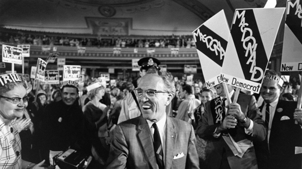 Tommy Douglas receives a standing ovation while arriving at the Palace Theatre to address an NDP rally in Hamilton, Ont. on June 11, 1968. The Canadian Press