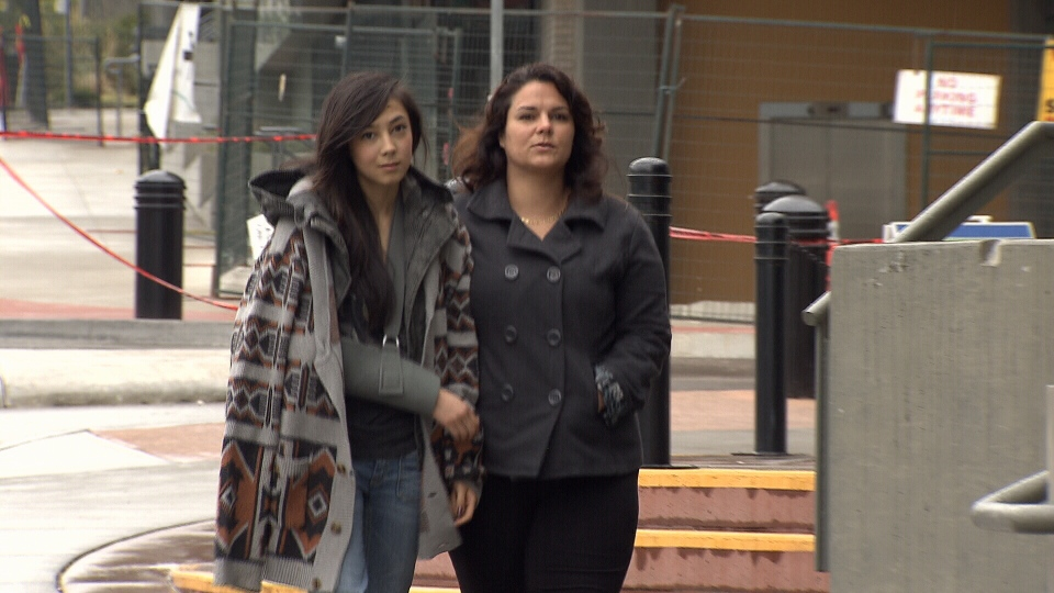The arm of  Tanika Coutlee, on left with her mother, was broken after she was arrested at a Vancouver all-ages concert.