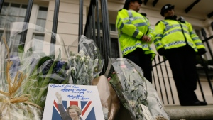 A card is left on a floral tribute outside former British Prime Minister Baroness Thatcher's home in London, Tuesday, April 9, 2013. (AP / Kirsty Wigglesworth)