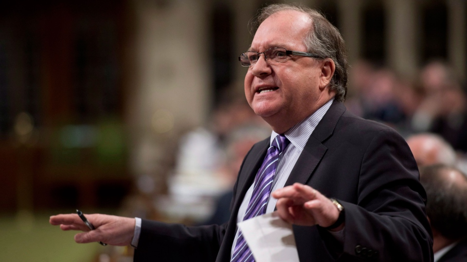 Minister of Aboriginal Affairs and Northern Development Bernard Valcourt responds to a question during question period in the House of Commons in Ottawa, Thursday, March 28, 2013. (Adrian Wyld / THE CANADIAN PRESS)