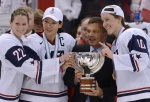 Team USA's Kacey Bellamy, Julie Chu and Meghan Duggan stand with IIHF president Rene Fasel as they are presented with the trophy after winning the IIHF Women's World Ice Hockey championship in Ottawa, Tuesday April 9, 2013. THE CANADIAN PRESS/Sean Kilpatrick