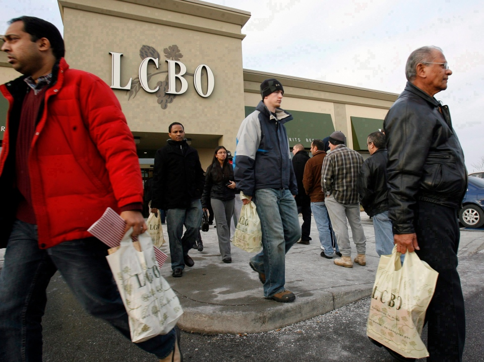 Patrons line up to get into an LCBO outlet as others leave after stocking up. Unionized LCBO employees have voted for strike action. (J.P. Moczulski / THE CANADIAN PRESS)
