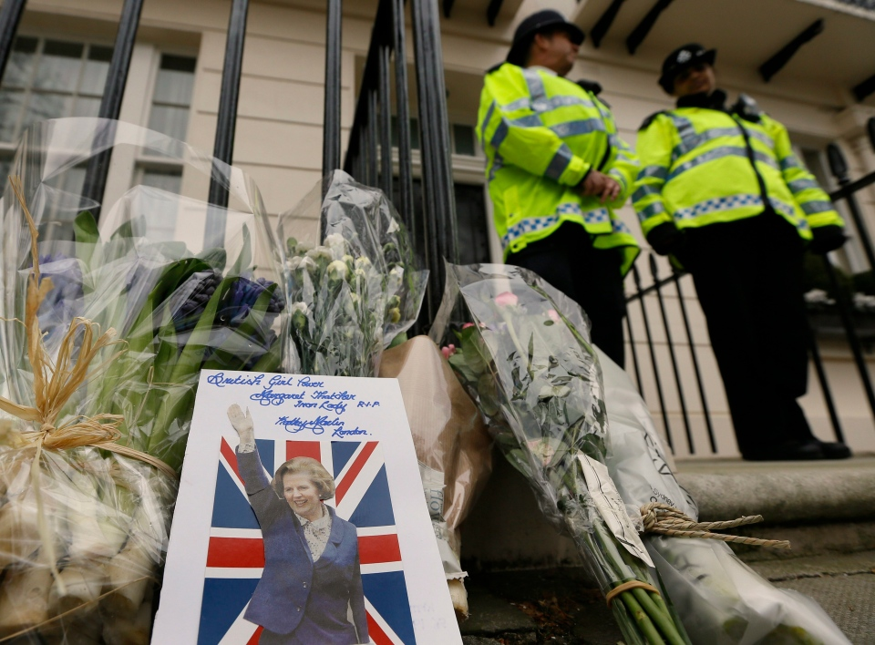 A card is left on a floral tribute outside former British Prime Minister Baroness Thatcher's home in London on April 9, 2013. (AP / Kirsty Wigglesworth)