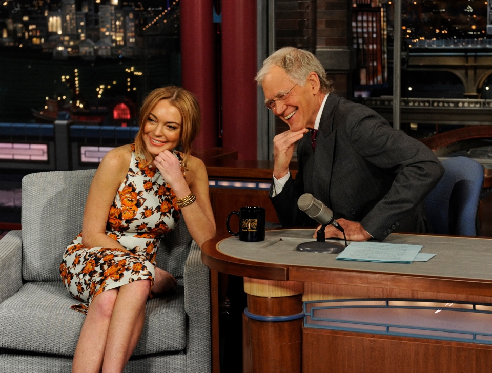 "Actress Lindsay Lohan talks to David Letterman about her upcoming trip to rehab during the ""Late Show with David Letterman"" on April 9, 2013. (CBS Entertainment/Jeffrey R. Staab)"