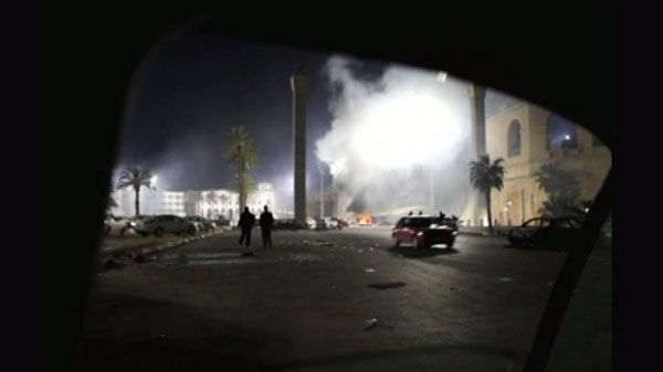 A fire burns in a street in the Libyan capital Tripoli in the early hours Tuesday Feb. 22, 2011 in this image taken from TV. (AP / APTN)