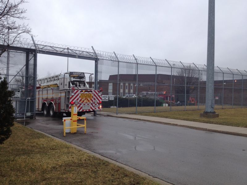 Emergency responders work at the scene of a fire at the Elgin Middlesex Detention Centre in London, Ont. on Wednesday, April 10, 2013. (Cristina Howorun / CTV London)