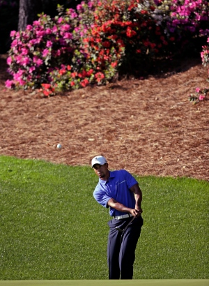 Tiger Woods chips to the 13th green during a practice round for the Masters golf tournament  in Augusta, Ga., on Wednesday, April 10, 2013. (AP/Matt Slocum)