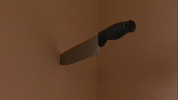 Knife in wall of rental suite