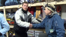 Nicklas Andersen shakes the hand of a North Shore Rescue team member after the crew rescued him and a friend off of Mount Seymour on Feb. 22, 2011. (CTV)