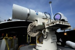 The Laser Weapon System (LaWS) temporarily installed aboard the guided-missile destroyer USS Dewey (DDG 105) in San Diego, Calif., in this July 2012 photo is a technology demonstrator built by the Naval Sea Systems Command from commercial fiber solid state lasers, utilizing combination methods developed at the Naval Research Laboratory. (US Navy / John F. Williams)