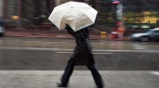 A pedestrian hides under her umbrella in this file photo. (The Canadian Press/Darren Calabrese)