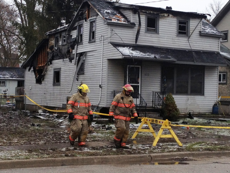 Firefighters examine the scene of a house fire in Listowel, Ont., on Thursday, April 11, 2013. (David Imrie / CTV Kitchener)