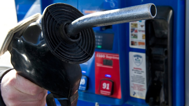 A man replaces the nozzle after filling up at a gas station Wednesday, February 23, 2011 in Montreal. (Paul Chiasso / THE CANADIAN PRESS)