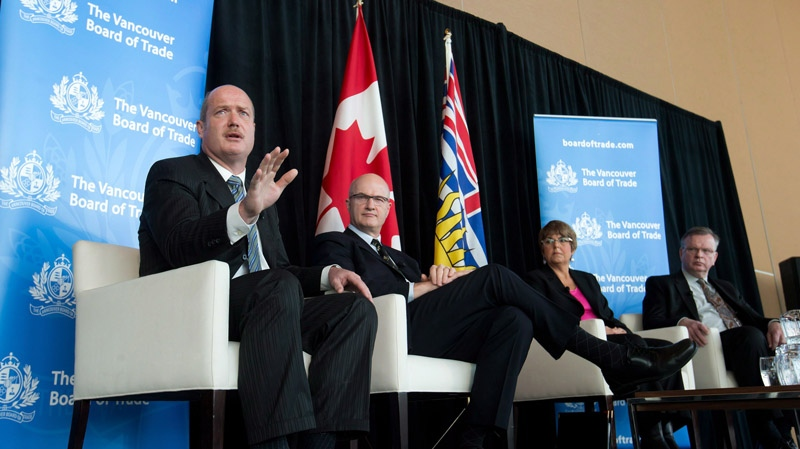British Columbia Finance Minister Mike de Jong, Minister of Jobs, Tourism and Skills Training Pat Bell and NDP MLA's Carole James and Bruce Ralston take part in a political panel at the 2013 BMO Economic Outlook Forum in Vancouver, B.C., on Thursday, Jan. 17, 2013. (Darryl Dyck / THE CANADIAN PRESS)
