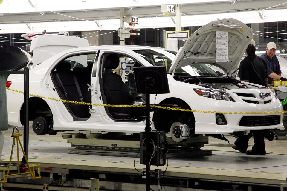 A Toyota Corolla chassis rolls down the assembly line at the Toyota automotive manufacturing facility in Blue Springs, Miss., Thursday, Oct. 25, 2012. (AP / Rogelio V. Solis)