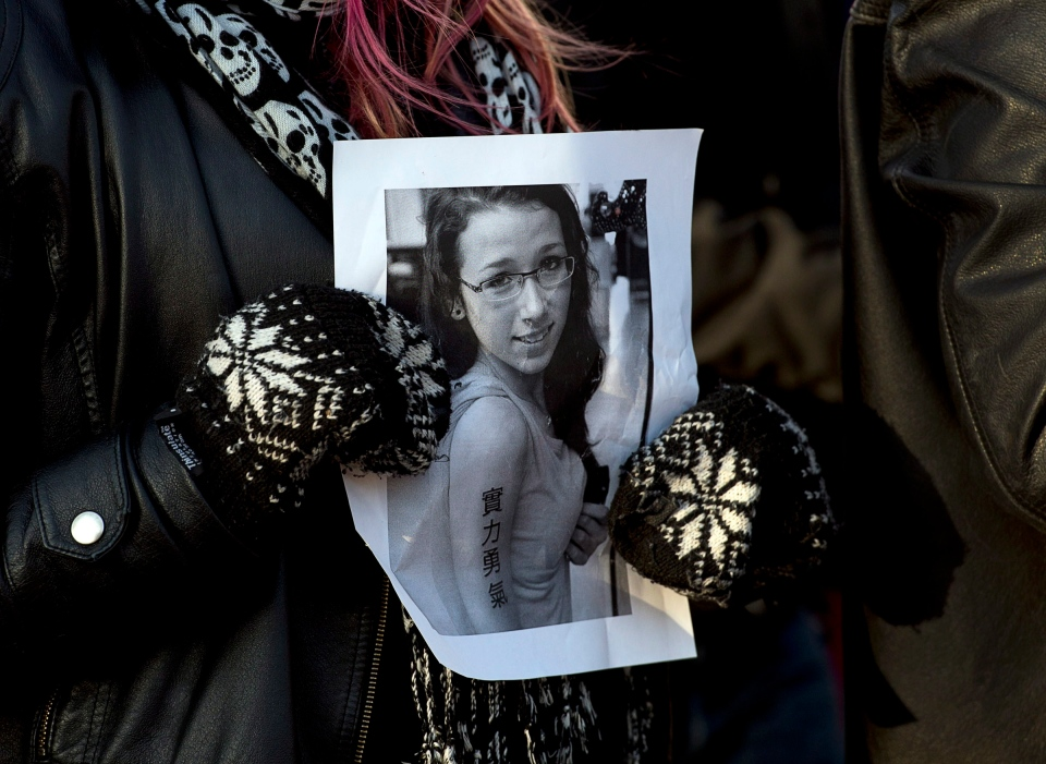 A woman holds a photo as several hundred people attend a community vigil to remember Rehtaeh Parsons at Victoria Park in Halifax on Thursday, April 11, 2013. (Andrew Vaughan / THE CANADIAN PRESS)