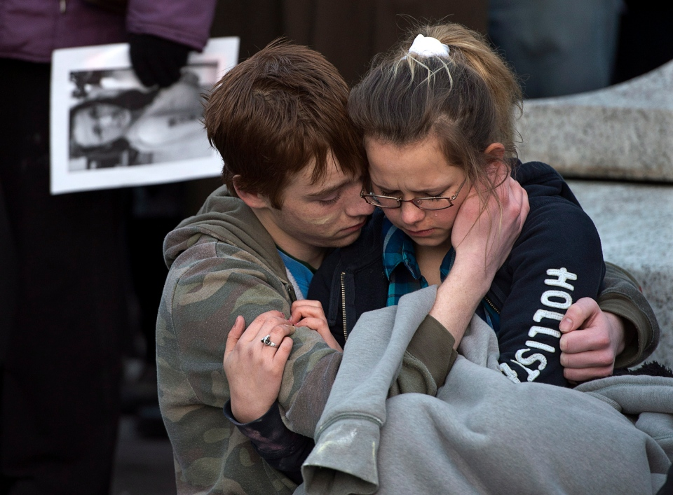 Friends embrace as several hundred people attend a community vigil to remember Rehtaeh Parsons at Victoria Park in Halifax on Thursday, April 11, 2013. (Andrew Vaughan / THE CANADIAN PRESS)