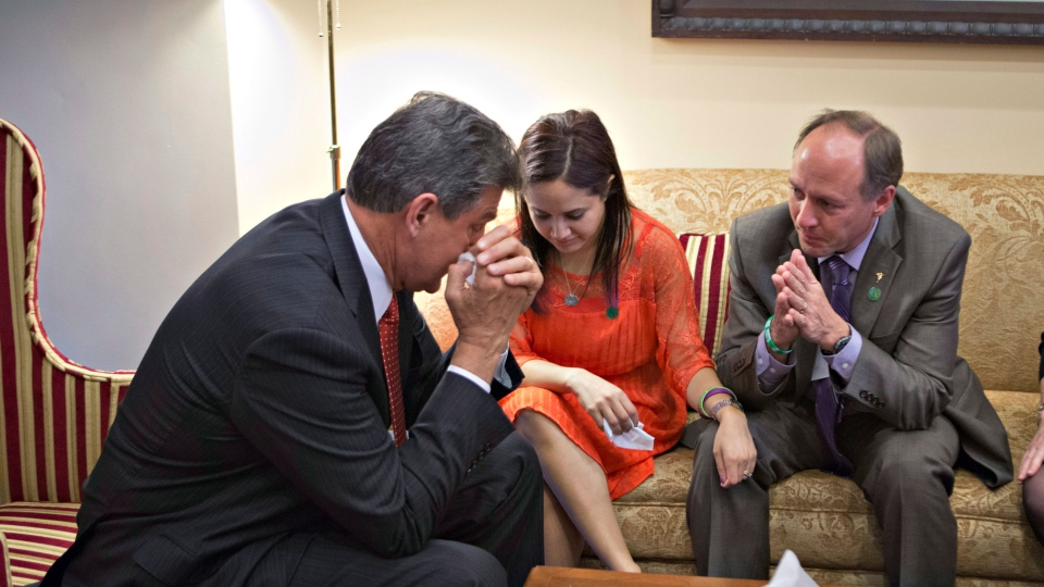 Sen. Joe Manchin, D-W.Va., left, becomes emotional as he meets in his office with families of victims of the Sandy Hook Elementary School shooting in Newtown, Conn., Wednesday, April 10, 2013 (AP / J. Scott Applewhite)
