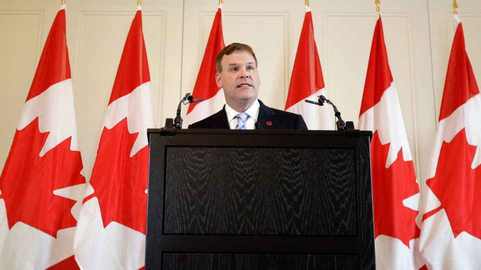 Canadian Foreign Affairs Minister John Baird talks to members of the media, during a news conference in central London, following the G8 foreign ministers' meeting, Thursday, April 11, 2013. (AP / Lefteris Pitarakis)