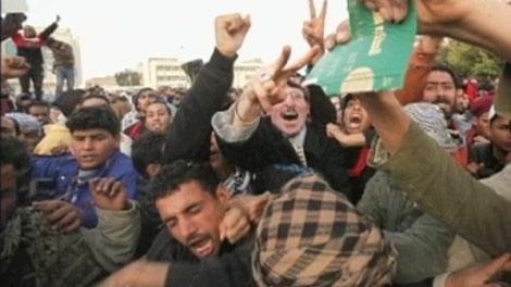 Heavy gunfire broke out in Tripoli as forces loyal to Moammar Gadhafi tightened their grip on the Libyan capital while anti-government protesters claimed control of many cities, Wednesday, Feb. 23, 2011.