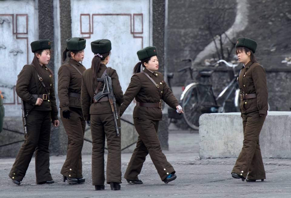 North Korean female soldiers perform marching exercises on the river bank of the North Korean town of Sinuiju, opposite to the Chinese border city of Dandong Thursday, April 11, 2013. (AP)
