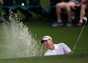 Sergio Garcia, of Spain, chips out of a bunker on the second green during the second round of the Masters golf tournament Friday, April 12, 2013, in Augusta, Ga. (AP Photo/Matt Slocum)