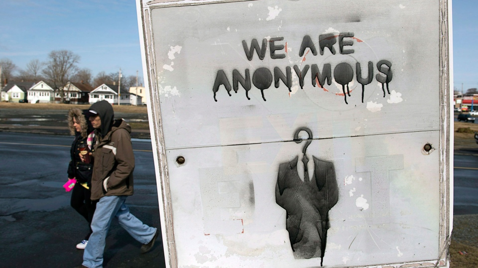 The RCMP said it's willing to work with hacktivist group Anonymous in the investigation of a Nova Scotia teen's death, as long as the groups' members take off their masks. (Andrew Vaughan / THE CANADIAN PRESS)