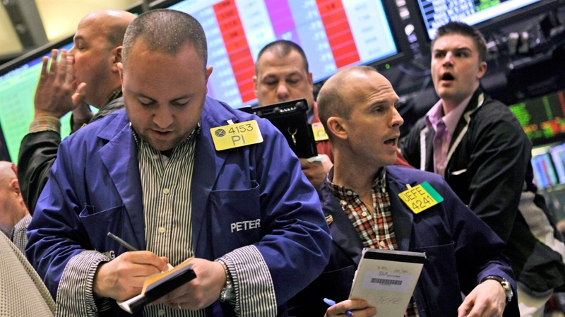 Traders work the crude oil options pit at the New York Mercantile Exchange Wednesday, Feb. 23, 2011 in New York.(AP / Mary Altaffer)