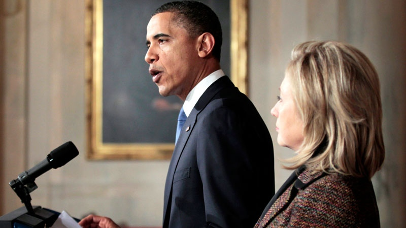 U.S. President Barack Obama, left, with U.S. Secretary of State Hillary Rodham Clinton, right, delivers a statement on Libya in the Grand Foyer of the White House in Washington, Wednesday, Feb. 23, 2011. (AP / Pablo Martinez Monsivais)