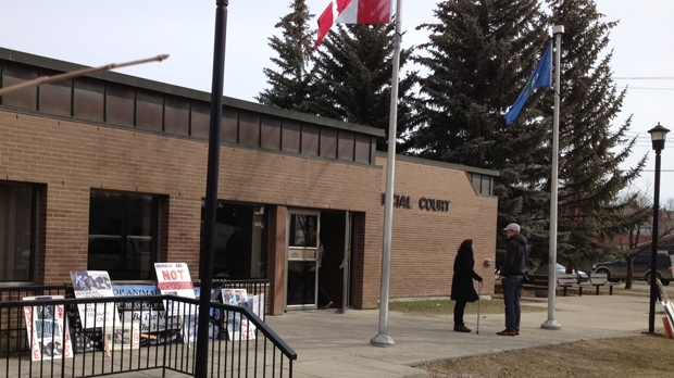 Picket signs outside of the Okotoks courthouse