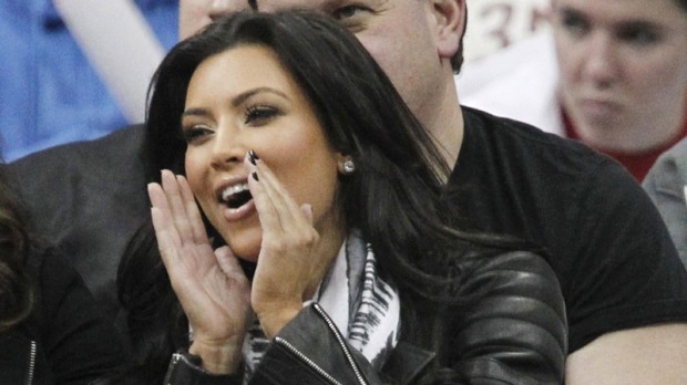 Actress Kim Kardashian shouts during the third quarter of an NBA basketball game between the New Jersey Nets and the Indiana Pacers, Sunday, Feb. 6, 2011, in Newark, N.J. (AP Photo/Julio Cortez)