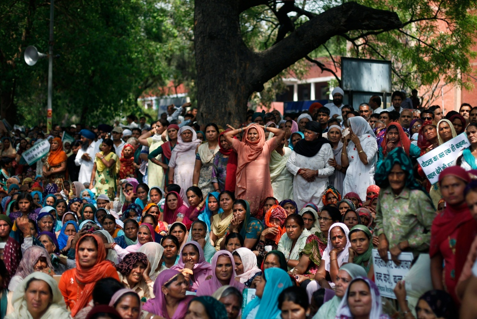 Protesters from the Indian state of Haryana listen to a speaker, unseen, while participating in a rally criticizing the rise in crimes against women in New Delhi, India, Wednesday, April 10, 2013. (AP / Altaf Qadri)