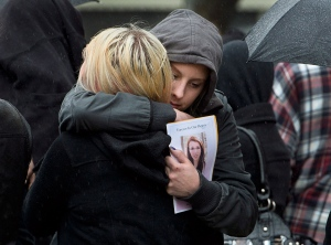 A community comes together to mourn the suicide of a Nova Scotia teen. Rehtaeh Parsons took her own life after she was raped by four boys and then endured a year-and-a-half of bullying by her schoolmates.<br><br>Friends of Rehtaeh Parsons embrace outside St. Mark&#39;s Anglican Church at her funeral in Halifax on Saturday, April 13, 2013. (Andrew Vaughan / THE CANADIAN PRESS)