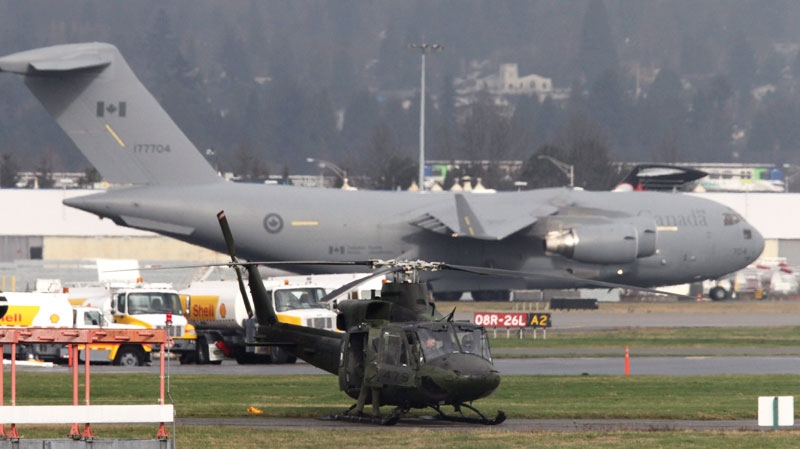 A Canadian Forces C-17 Globemaster taxis for takeoff at Vancouver International Airport in Richmond, B.C., on Wednesday, Feb. 3, 2010. (Darryl Dyck / THE CANADIAN PRESS)