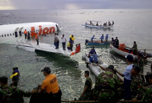 Rescuers are seen at the crash site of a Lion Air plane in Bali, Indonesia on Saturday, April 13, 2013. (AP / National Rescue Team)