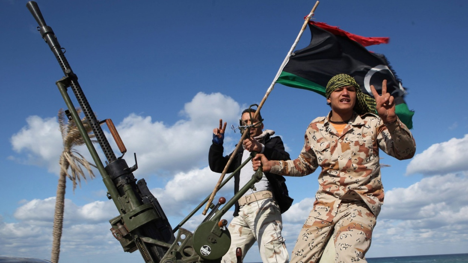 Libyan militias from towns throughout the country's west parade through Tripoli, Libya in this Tuesday, Feb. 14, 2012 file photo. (AP / Abdel Magid Al Fergany)