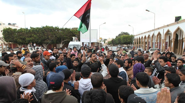 n this photo released by China's Xinhua News Agency, people attend a protest in the eastern Libyan town of Derna Wednesday, Feb. 23, 2011. (AP / Xinhua, Nasser Nouri)