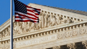 An American flag flies in front of the Supreme Court in Washington in June, 2012. (Alex Brandon / AP)