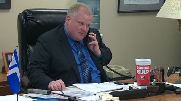 Rob Ford speaks on the phone in his office in Toronto on Friday, Feb. 25, 2011