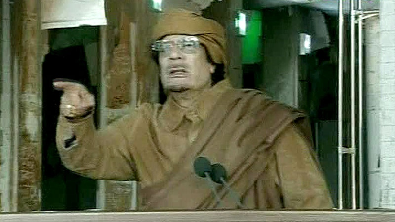This image broadcast on Libyan state television shows Libyan leader Moammar Gadhafi as he addresses the nation in Tripoli, Libya, Tuesday, Feb. 22, 2011. (AP / Libya State Television via APTN)