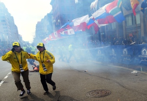 Tears, blood and fatal injuries were the result of two explosions that went off at the finish line of the Boston Marathon on Monday, April 15, 2013.<br><br> People react to an explosion at the 2013 Boston Marathon in Boston, Monday, April 15, 2013. (The Boston Globe / John Tlumacki)