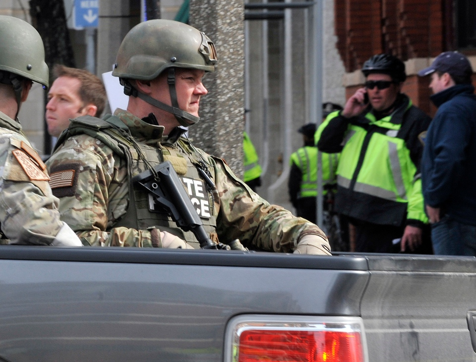 Armed Massachusetts State Police roll into the area following an explosion at the 2013 Boston Marathon in Boston, Monday, April 15, 2013. (AP / Josh Reynolds)