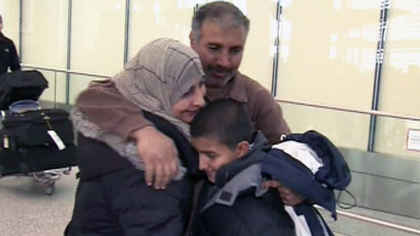 Ali Suleiman reunites with his family at Toronto's Pearson International Airport on Friday, Feb. 25, 2011.