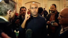 Seif al-Islam Gadhafi, son of Libyan Leader Moammar Gadhafi, speaks to the media after a press conference in a hotel in Tripoli, Libya Friday, Feb. 25, 2011. (AP / Ben Curtis)