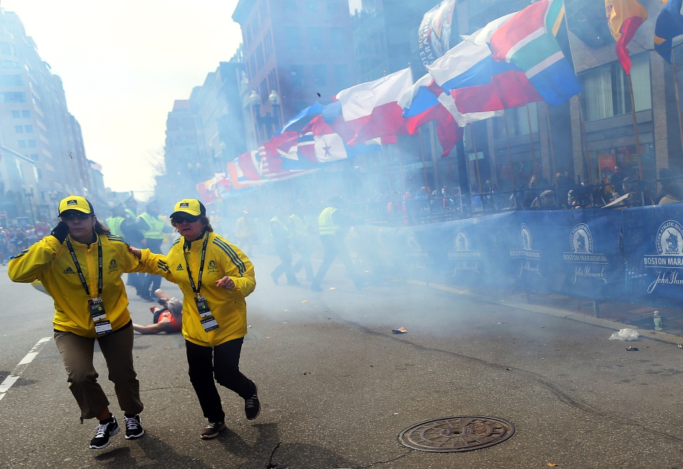 People react to an explosion at the 2013 Boston Marathon in Boston, Monday, April 15, 2013. (The Boston Globe / John Tlumacki)