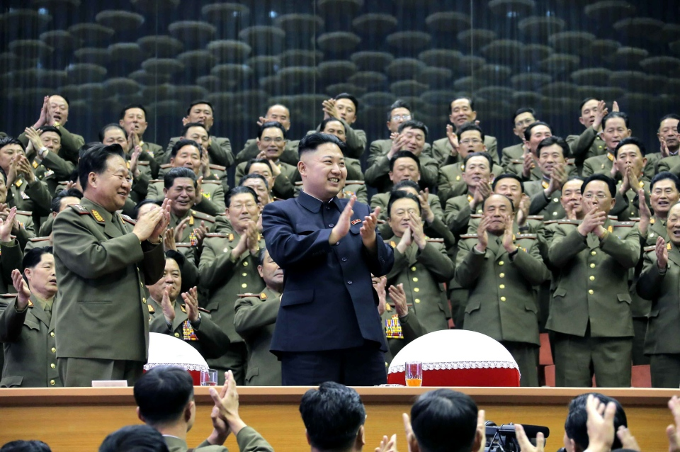 North Korean leader Kim Jong Un applauds as he visits an athletics contest held by Kim Il Sung University of Politics and Kim Il Sung Military University at a stadium in North Korea. (KCNA/KNS)